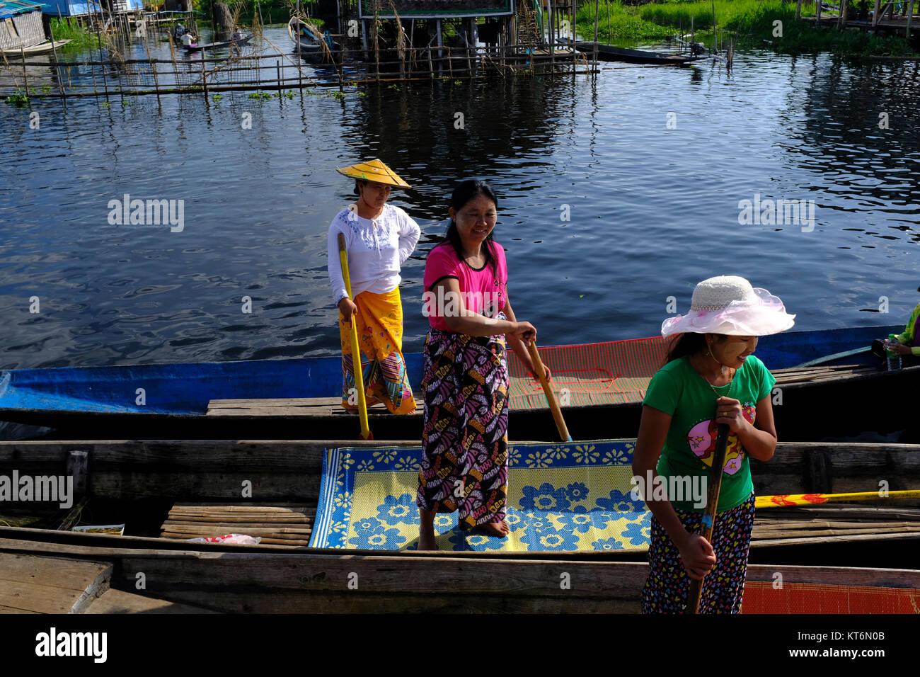 Female boattenders on Inle Lake in Myanmar Stock Photo