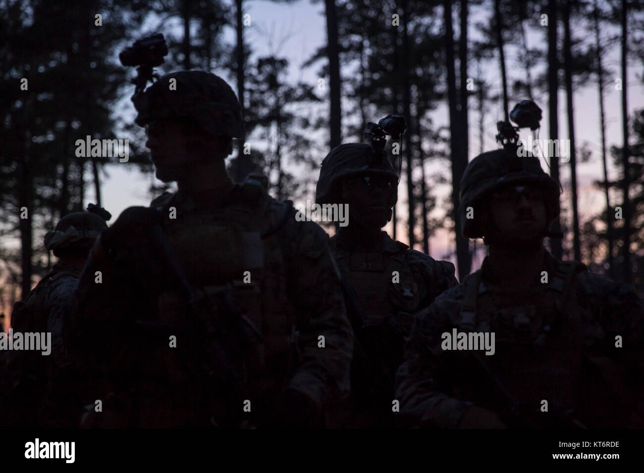 U.S. Marines with Company F., 2nd Battalion, 8th Marine Regiment, stage before performing a night live fire assault Stock Photo