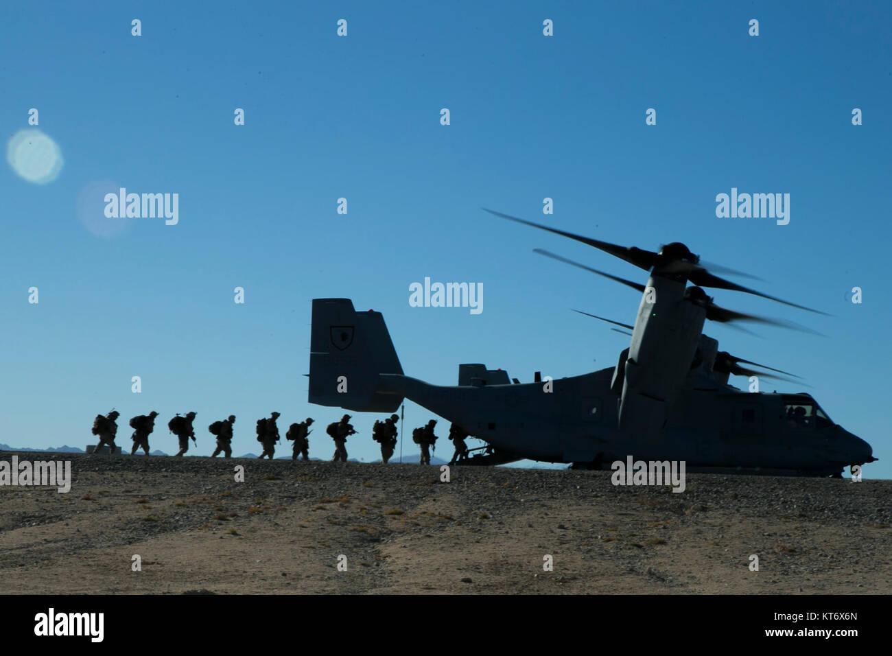 U.S. Marines with 2nd Battalion, 5th Marine Regiment, 1st Marine Division (MARDIV), board an MV-22 Osprey aircraft - Stock Image