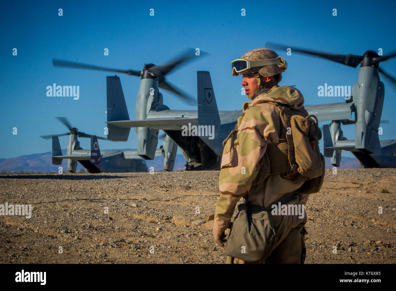 A U.S. Marine with 2nd Battalion, 5th Marine Regiment, 1st Marine Division, prepares to depart a landing strip during - Stock Image