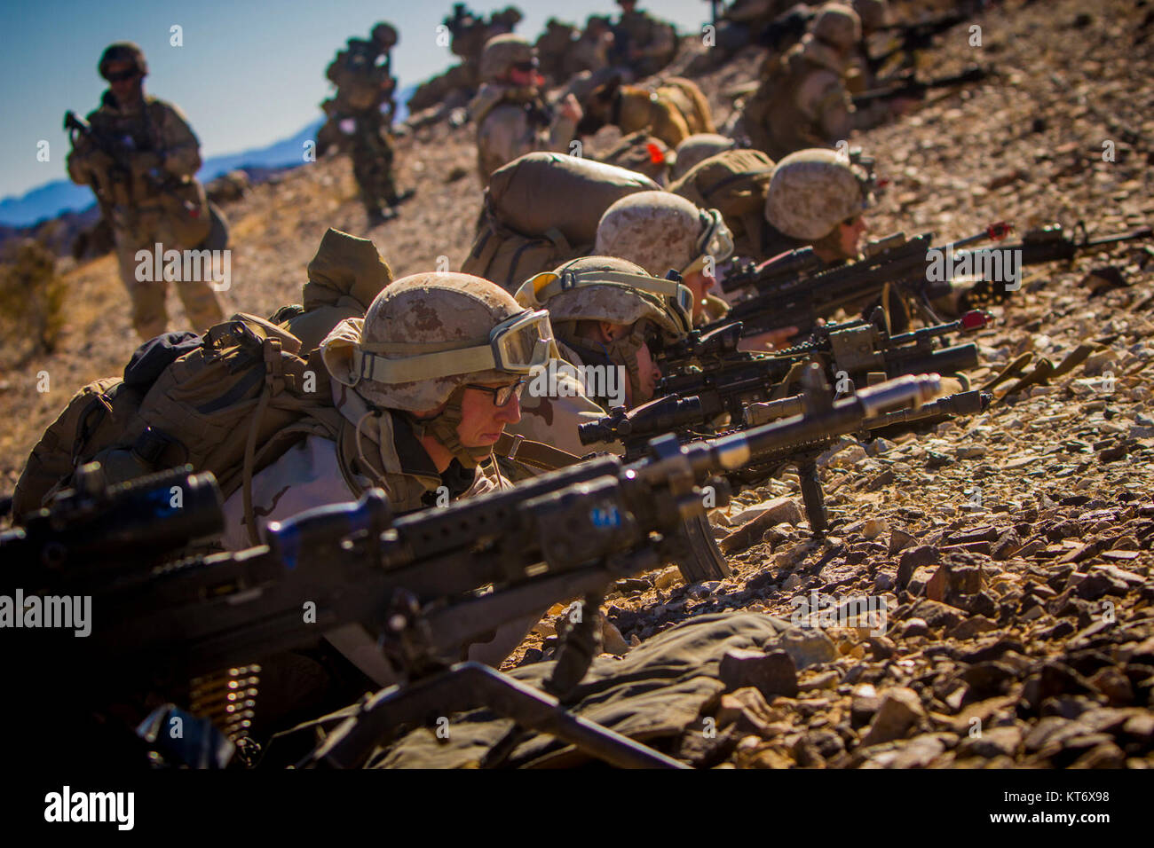 U.S. Marines with 2nd Battalion, 5th Marine Regiment, 1st Marine Division, provide cover fire during an air assault, - Stock Image