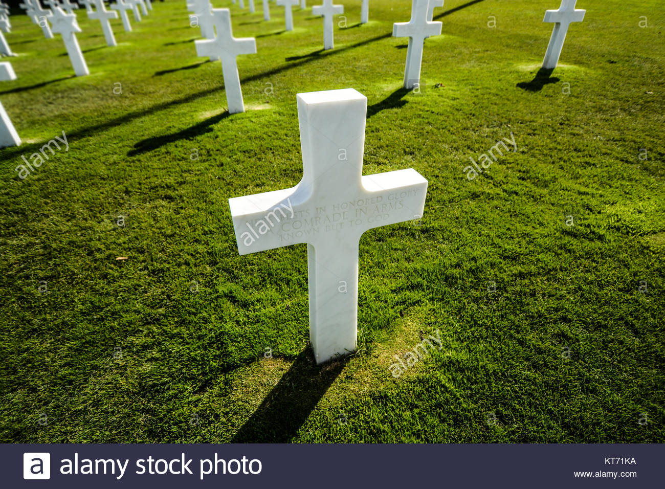 A marker over the military grave of an American soldier at the Normandy American Cemetery at Colleville-sur-Mer Stock Photo