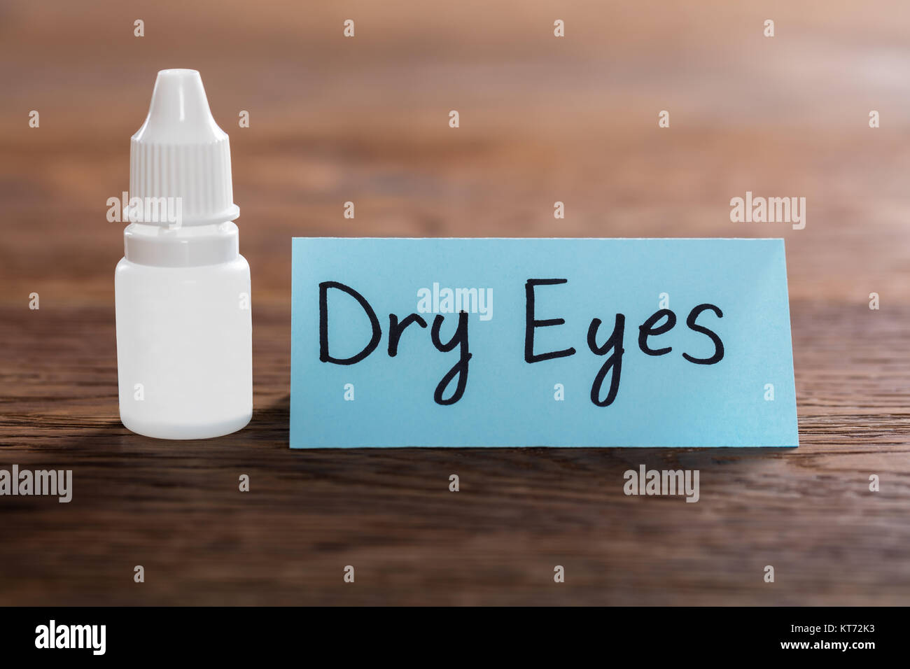Dry Eyes Concept On Wooden Desk - Stock Image