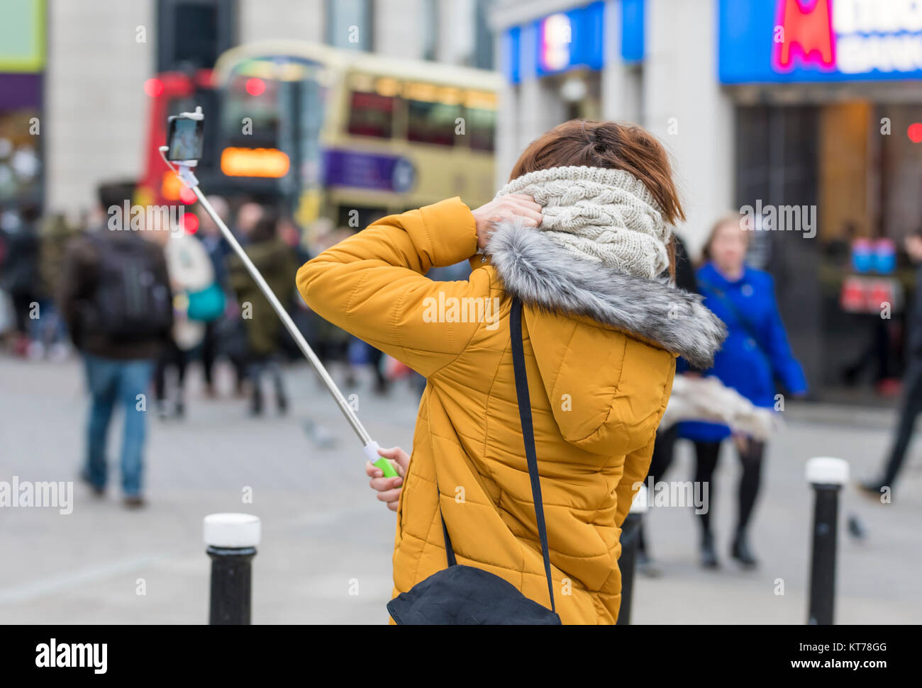 Tourist taking selfies with a selfie stick in England, UK. - Stock Image
