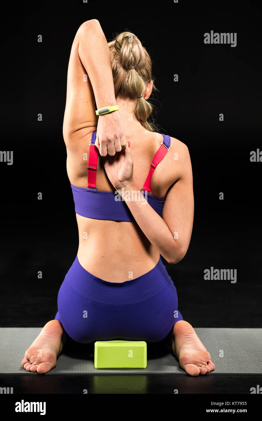 Athletic woman stretching - Stock Image