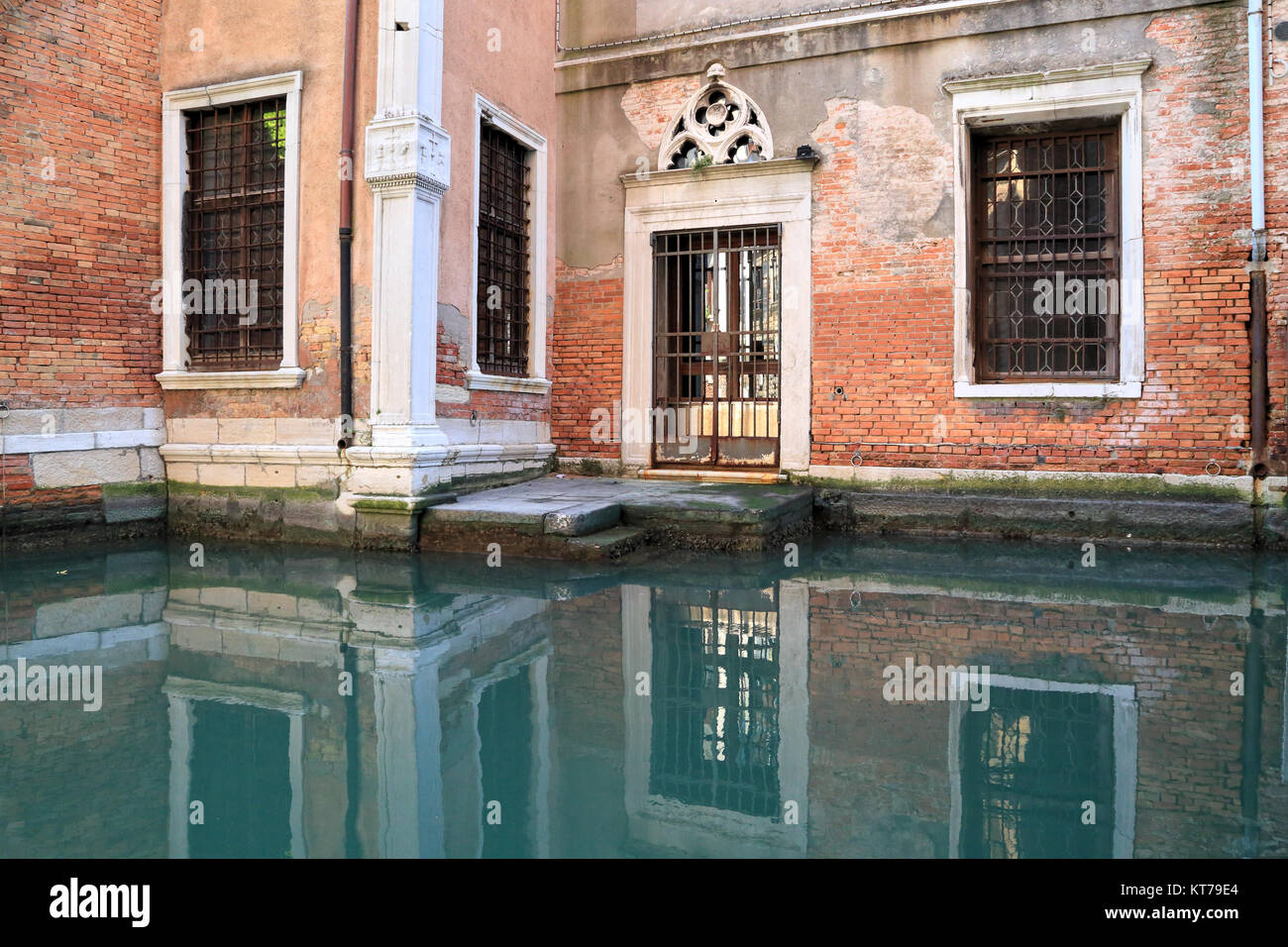 Venice church, mystic canal reflections, Ospizio Badoer - Stock Image