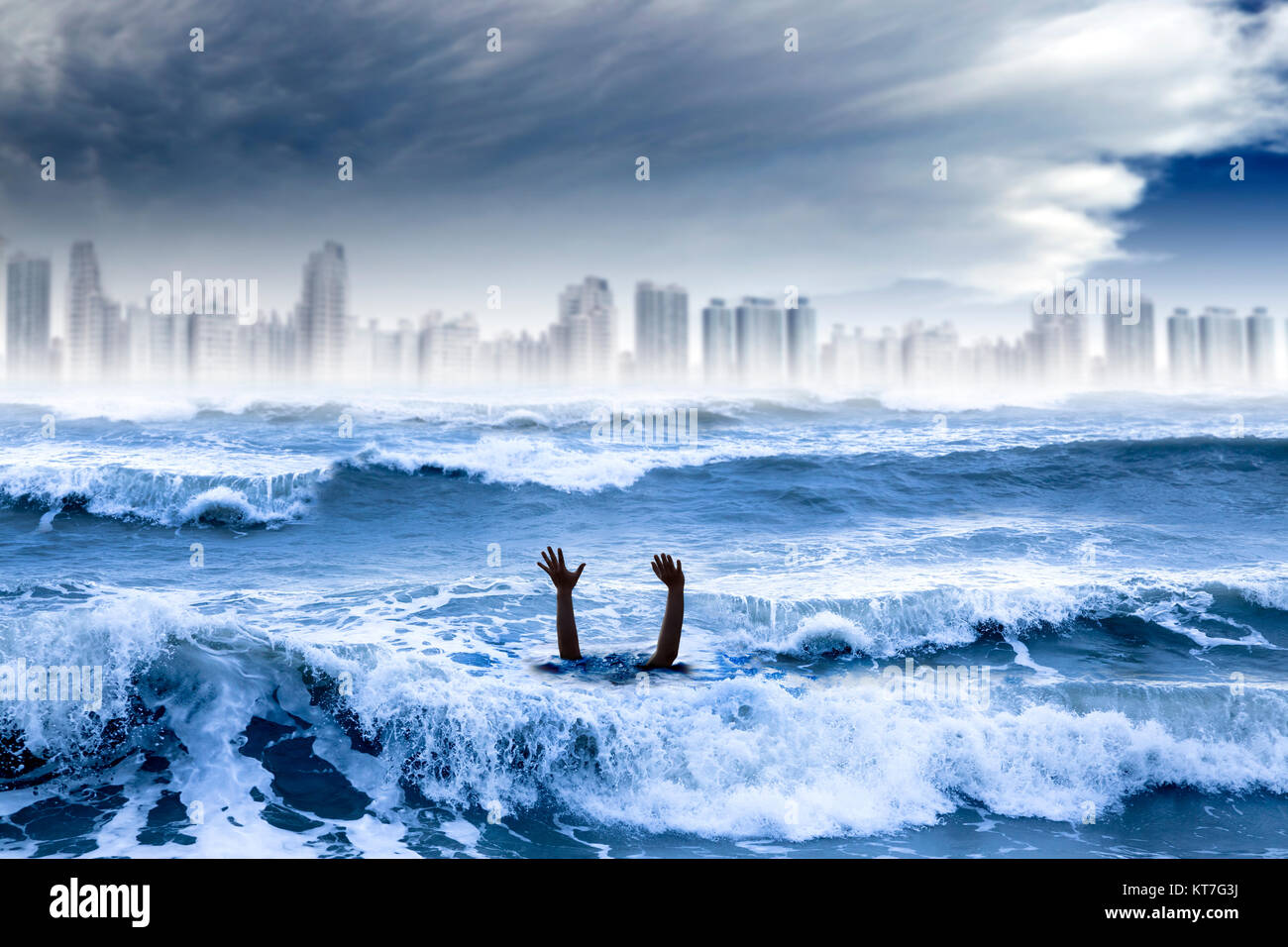 global warming and extreme weather concept. man drowning in the water and storm destroyed the city - Stock Image