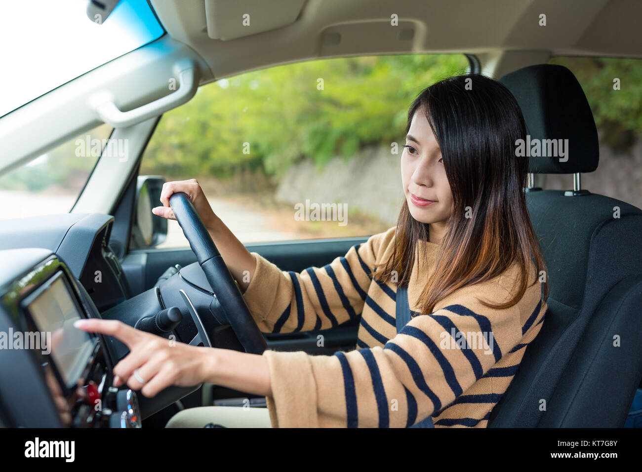 Woman using GPS system on car - Stock Image