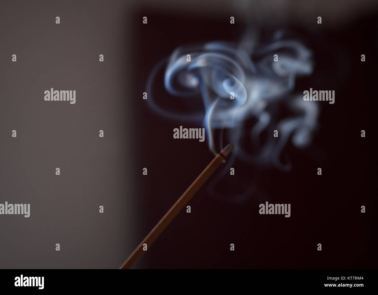 Incense smoke turbulent diffusion into eddies, an example of fluid dynamics and non lineal physics phenomena - Stock Image