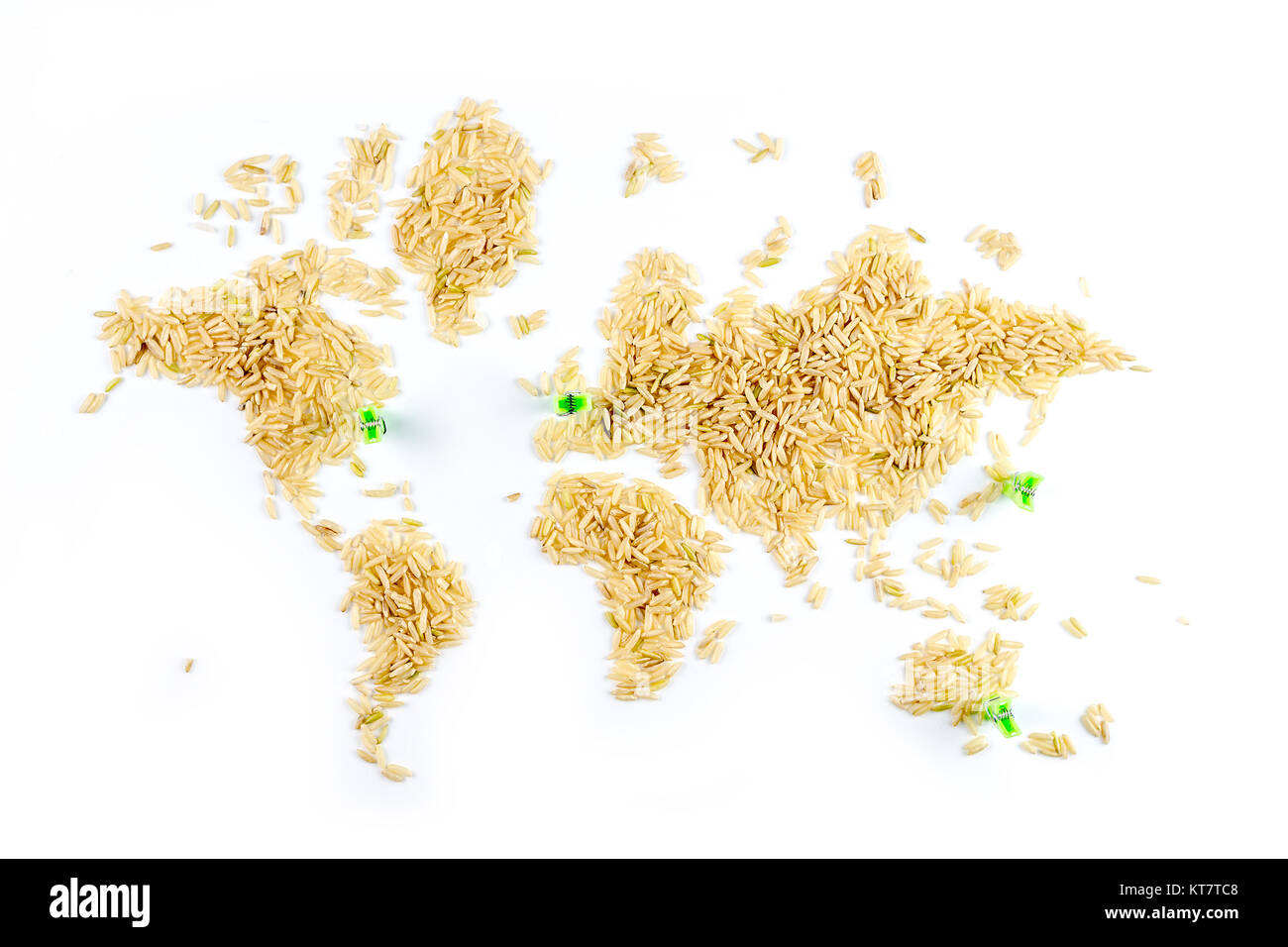 map of the world made of raw natural rice on white background with little green clothes pegs pointing sydney, tokio, - Stock Image