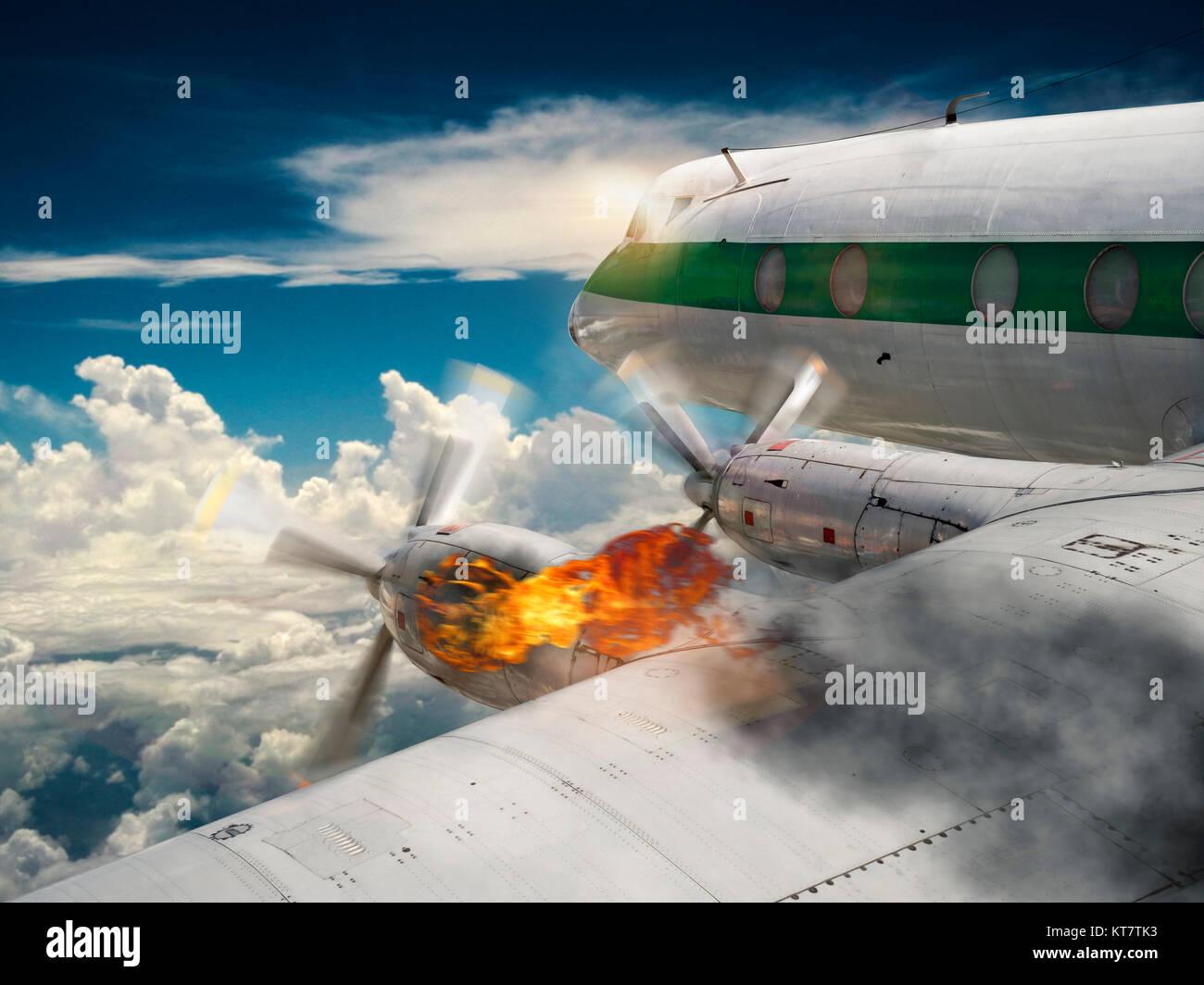 airplane with burning engine - Stock Image
