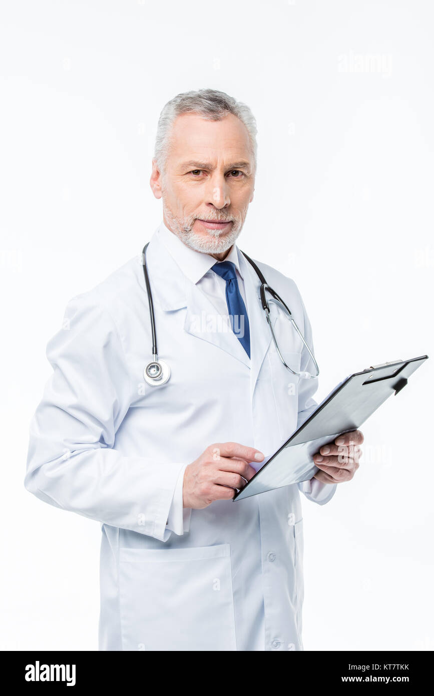 Doctor holding clipboard - Stock Image