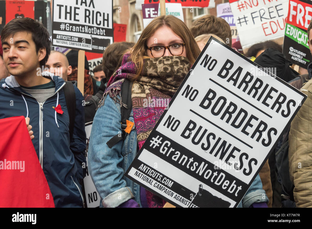 Marchers at the start of the NCAFC Student march for free education with a placard 'No Barriers, No Borders, - Stock Image