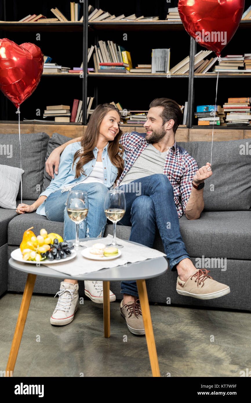 Couple with air balloons - Stock Image