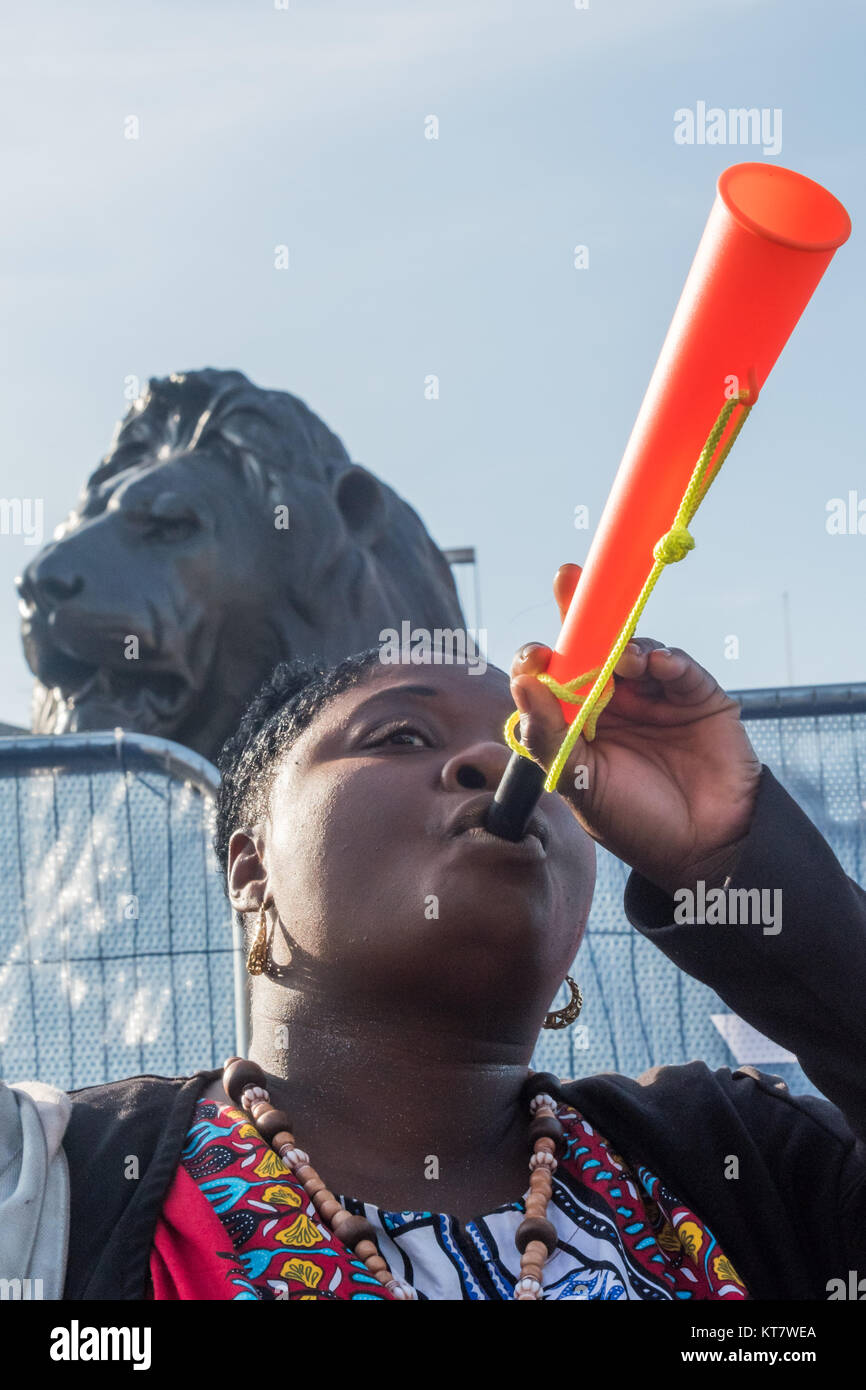A woman blows a vuvuzela in Trafalgar Square at the start of the annual protest by Families and friends of people - Stock Image