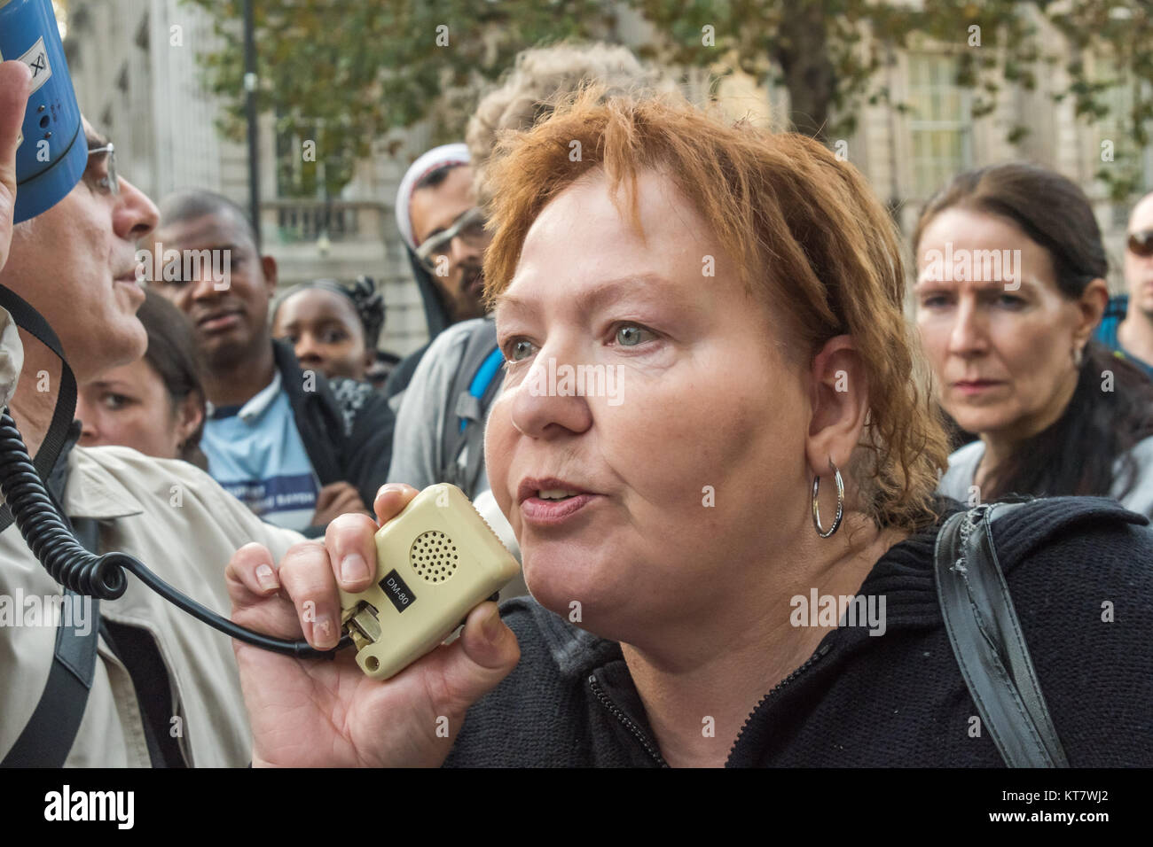 Mrs Briggs speaks about the killing of her son Leon Briggs at the rally by United Friends and Family at Downing - Stock Image