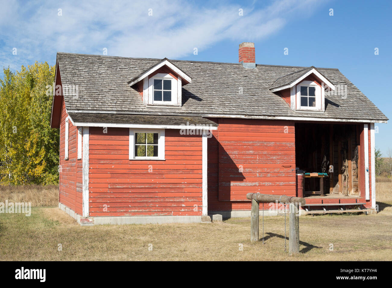 Harness Repair shop built c 1909, with hitching post in front, Bar U Ranch National Historic Site - Stock Image