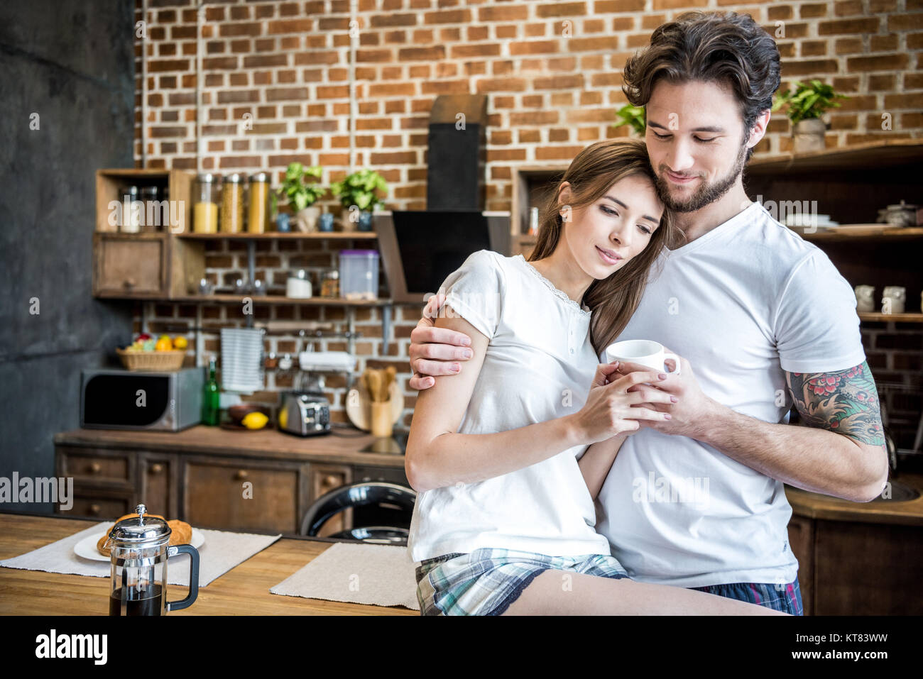 Couple holding coffee cup Stock Photo