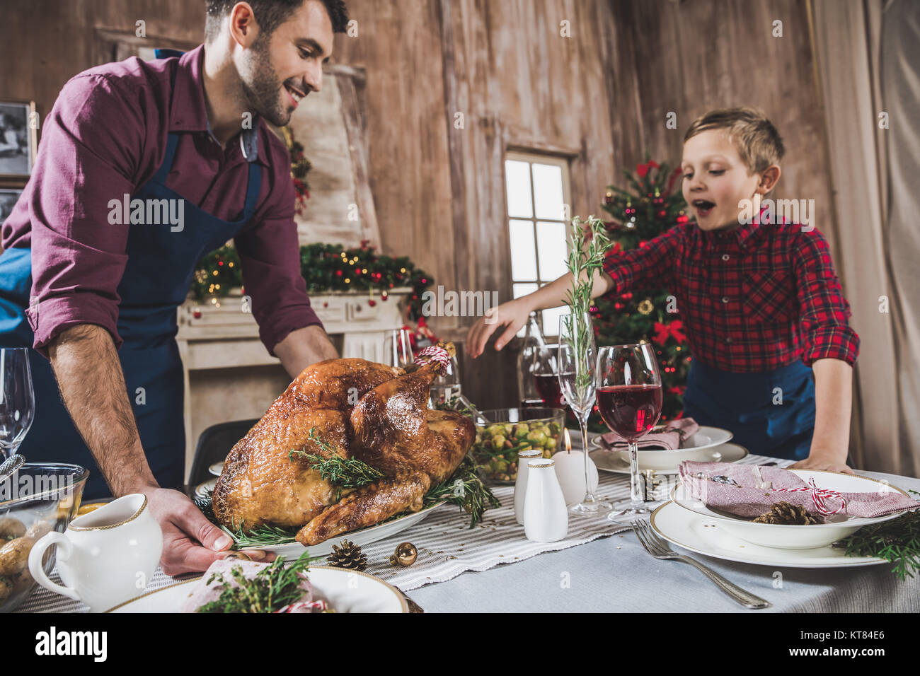 Father and son serving festive table Stock Photo