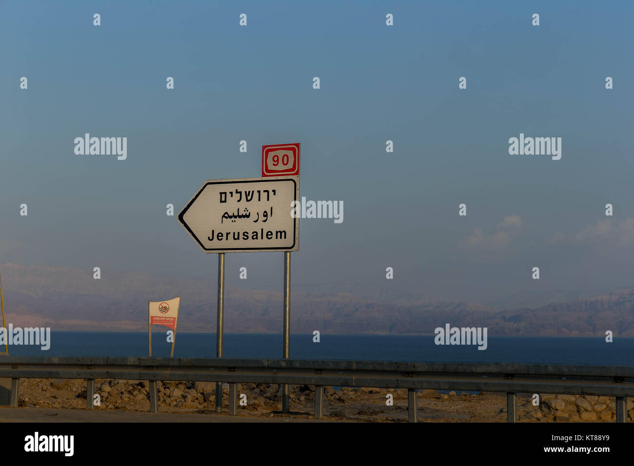 Road sign in three languages point the direction Jerusalem - Stock Image