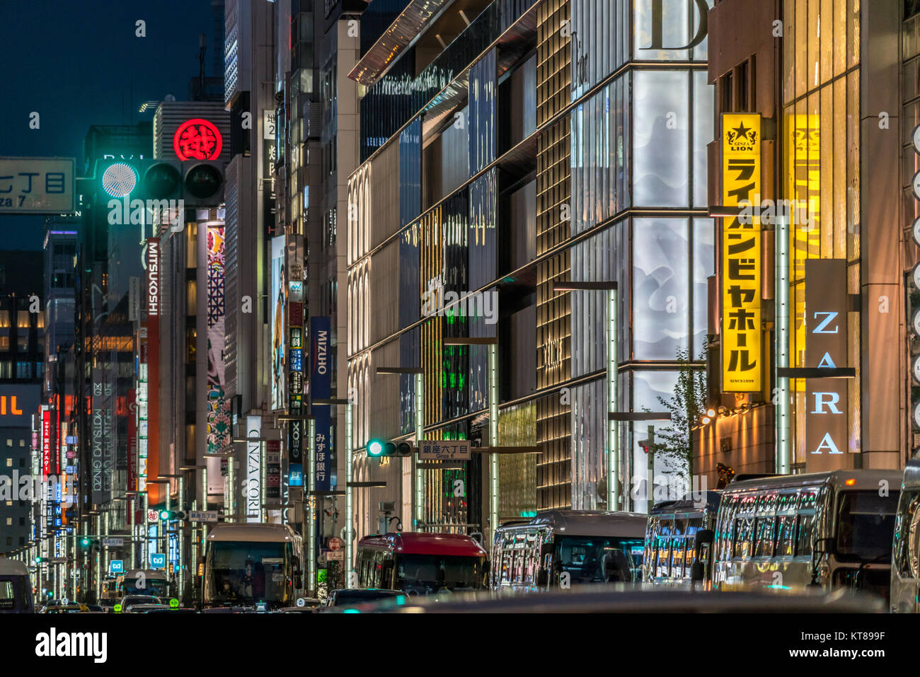 Ginza, Tokyo - December 2017 : Billboards and neon signs and heavy traffic at Chuo dori street at Ginza luxurious Stock Photo