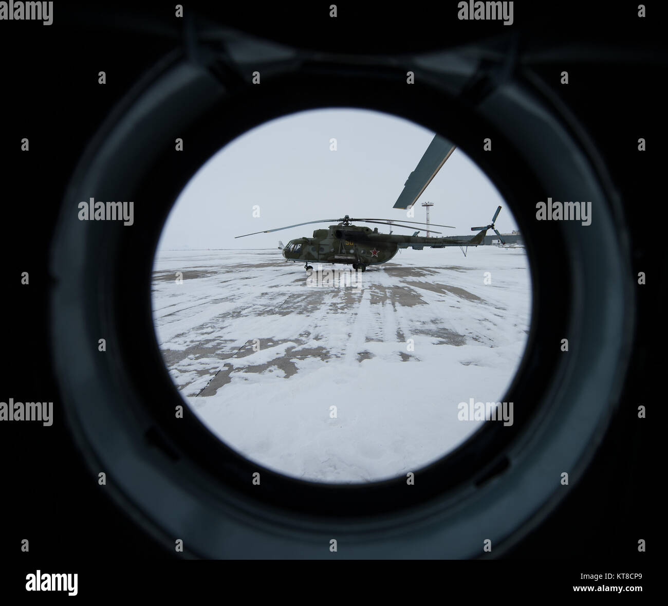 A Russian MI-8 helicopter is seen through the window of another helicopter at the Karanganda Airport shortly after - Stock Image