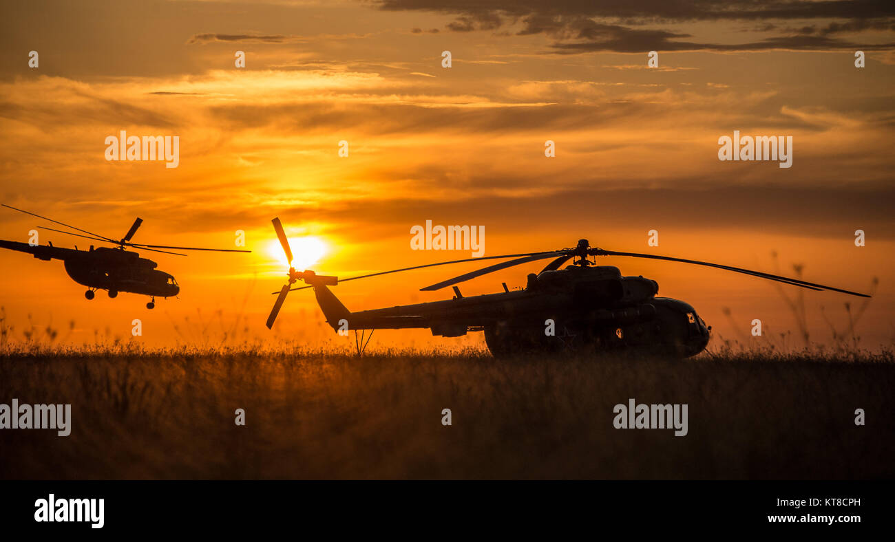 A Russian Search and Rescue  helicopter departs the Soyuz TMA-15M spacecraft landing site after the capsule landed - Stock Image