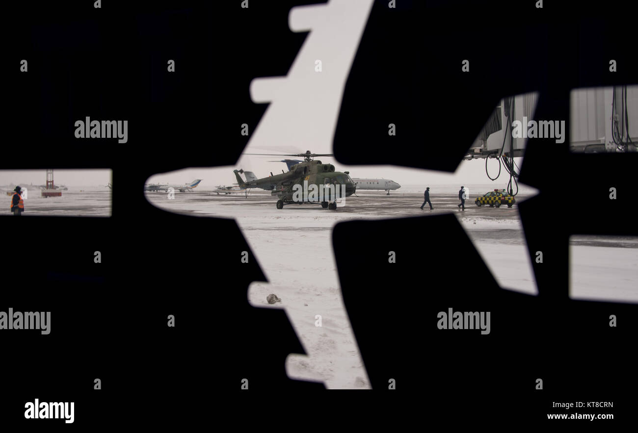A Russian MI-8 Helicopter is seen through the airport bus decal a day before the Soyuz TMA-14M spacecraft landing - Stock Image