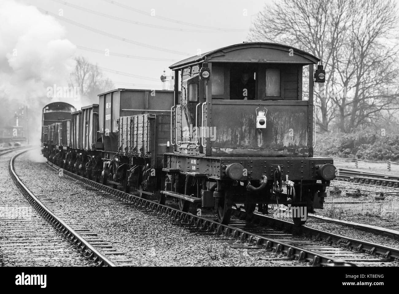 Former Southern Railway 0-6-0 Steam Locomotive 30543 hauls a rake of assorted freight wagons and guards van on the - Stock Image