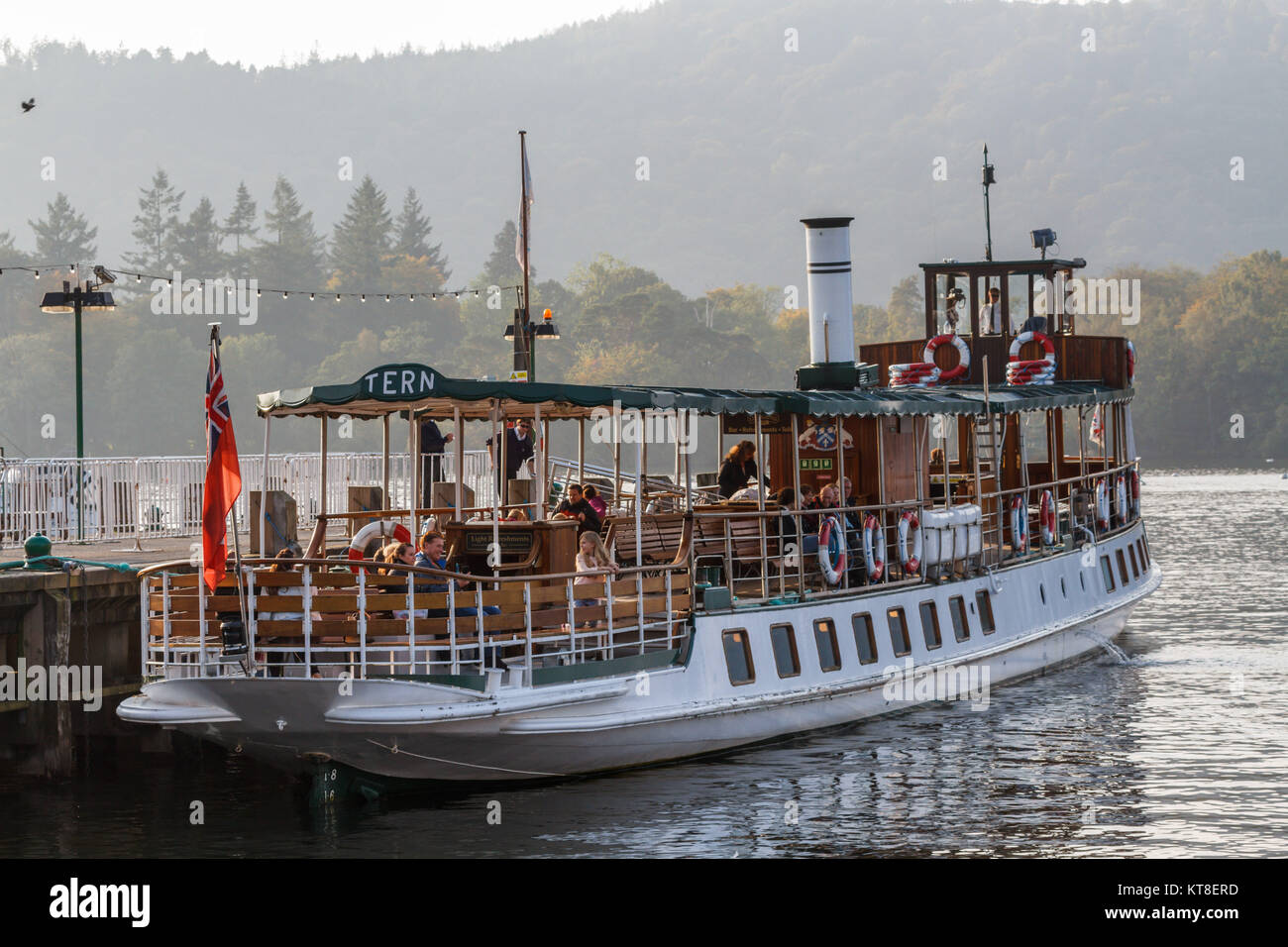 Former Steam Powered Cruise Ship 'Tern' with day-trippers at Ambleside on Lake Windermere in The Lake District, - Stock Image