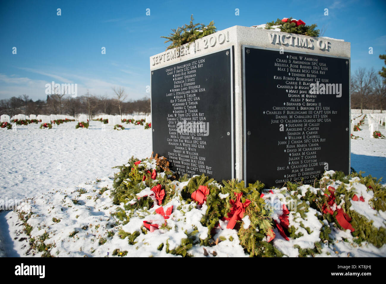 snow blankets wreaths headstones and the 9 11 memorial in arlington