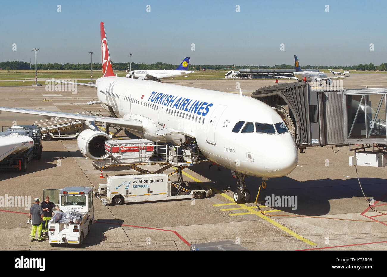 Hanover, Lower Saxony, Germany, July 1st 2015: Hanover Airport with Turkish aircraft while loading for the flight - Stock Image