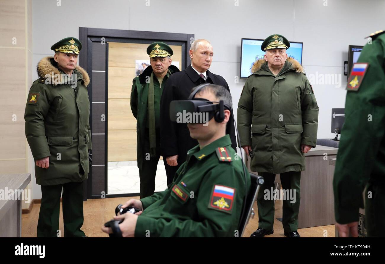 Balashikha, Russia. 22nd Dec, 2017. Russian President Vladimir Putin, center, with Defence Minister Sergei Shoigu, - Stock Image