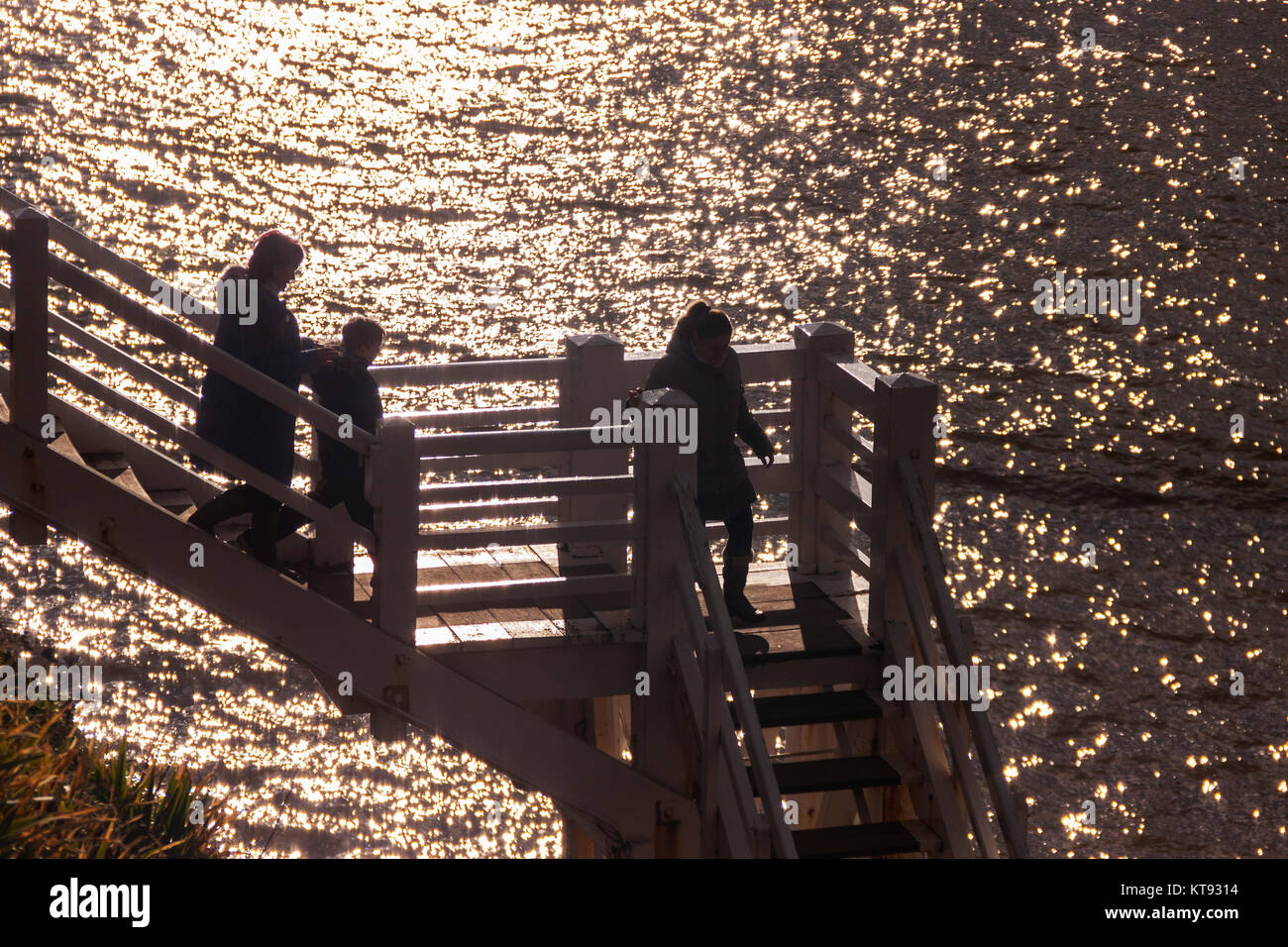 Sidmouth, Devon. 23rd Dec, 2017. UK Weather: People walk down Jacob's Ladder to the west beach at Sidmouth, - Stock Image
