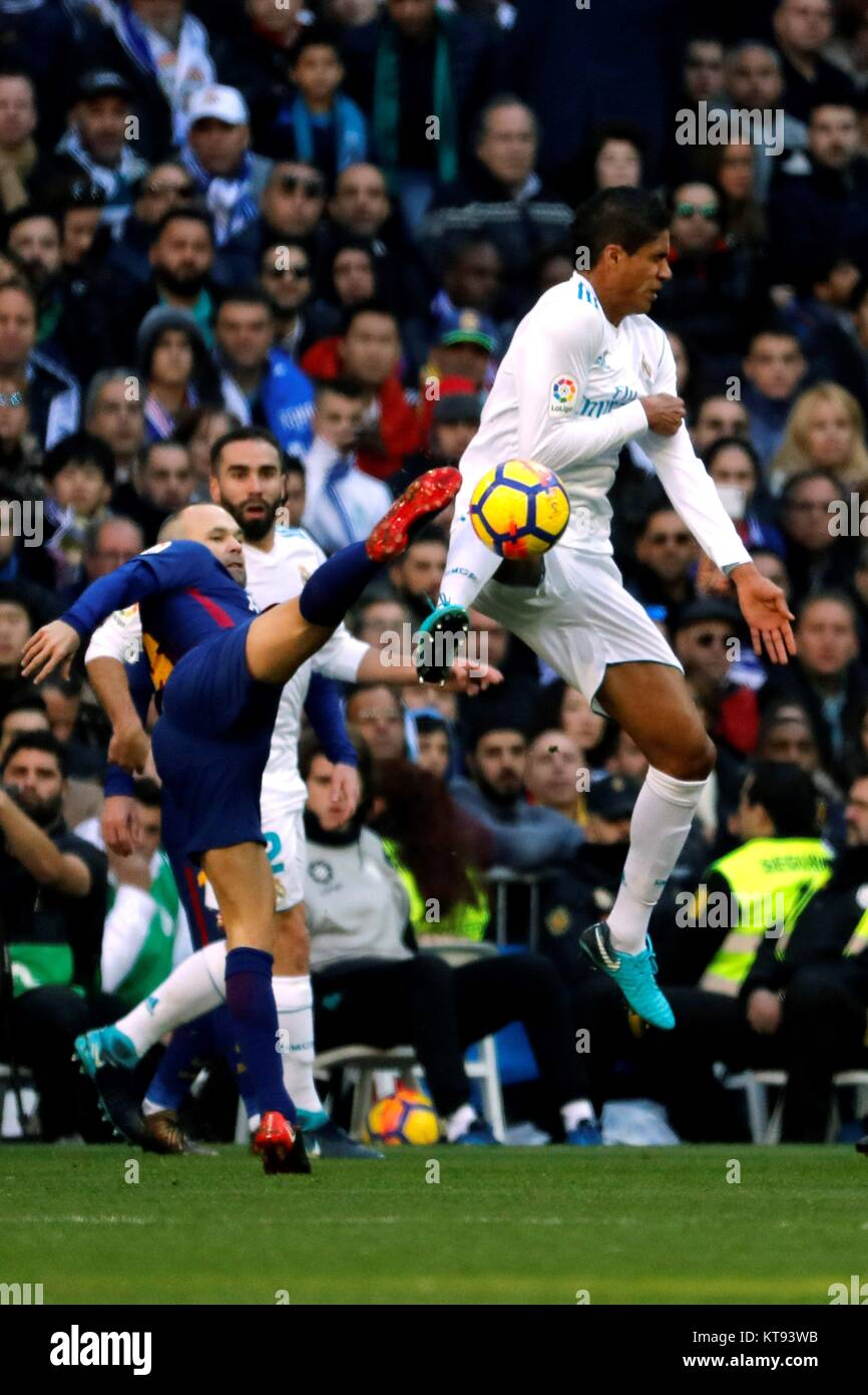 aca84cee10e Real Madrid s French defender Raphael Varane (R) in action against FC  Barcelona s Andres Iniesta during the Spanish Primera Division League s  soccer match ...