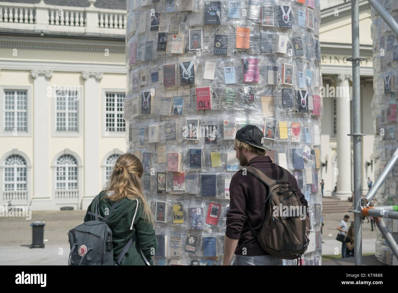 Visitors looking at documenta 14 Art Installation Pantheon of Booky by Marta Minujin on Friedrich Square in Kassel - Stock Image