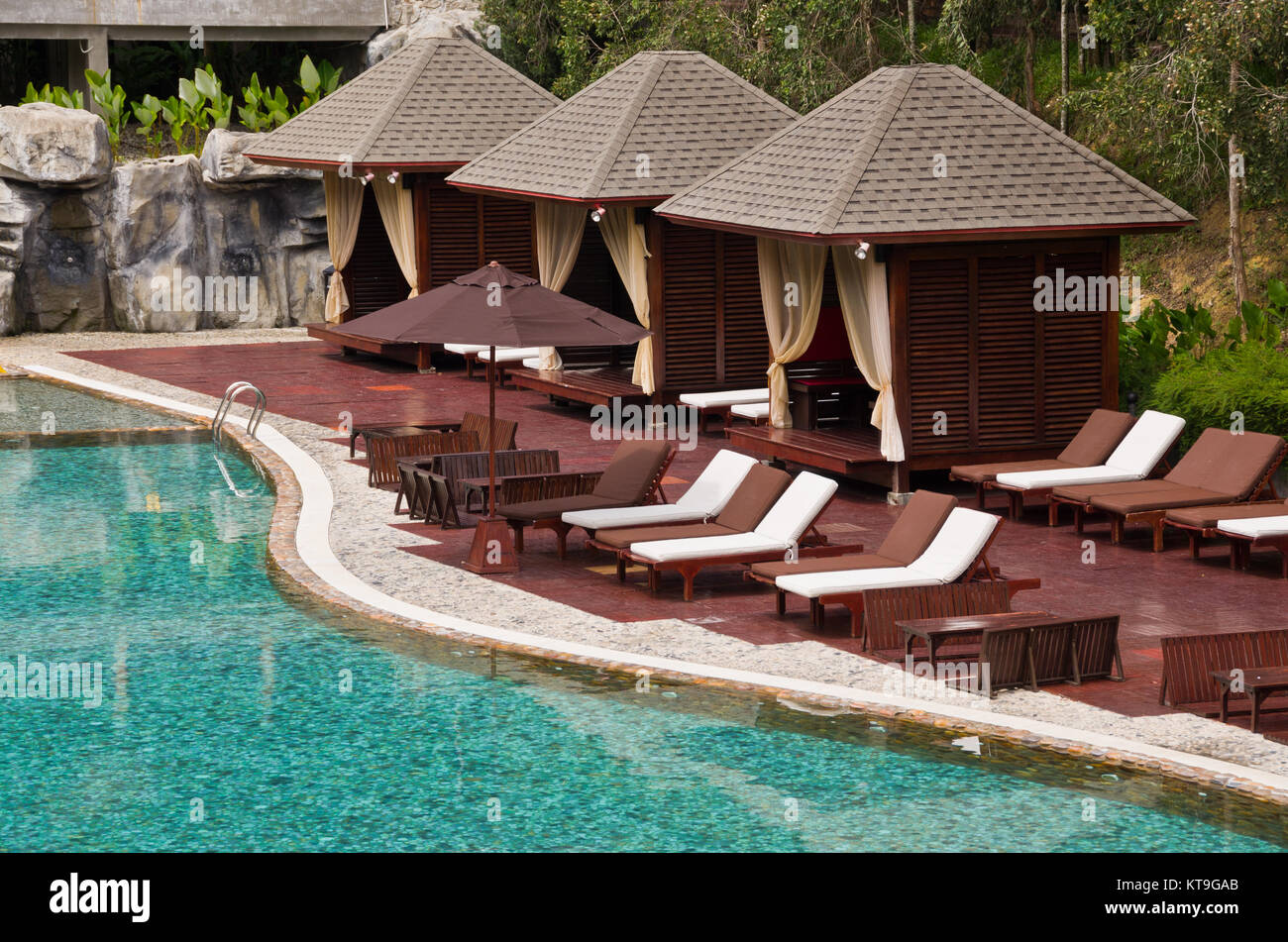 Beautiful Swimming Pool, Chair and Hut in tropical resort ...