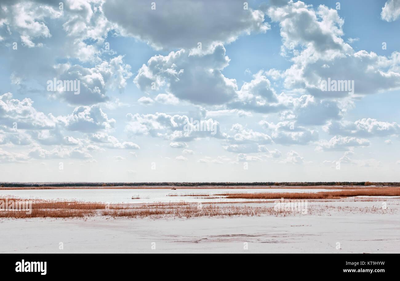 Lake Among Quartz Sand Under Beautiful Cloudy Sky Stock Photo