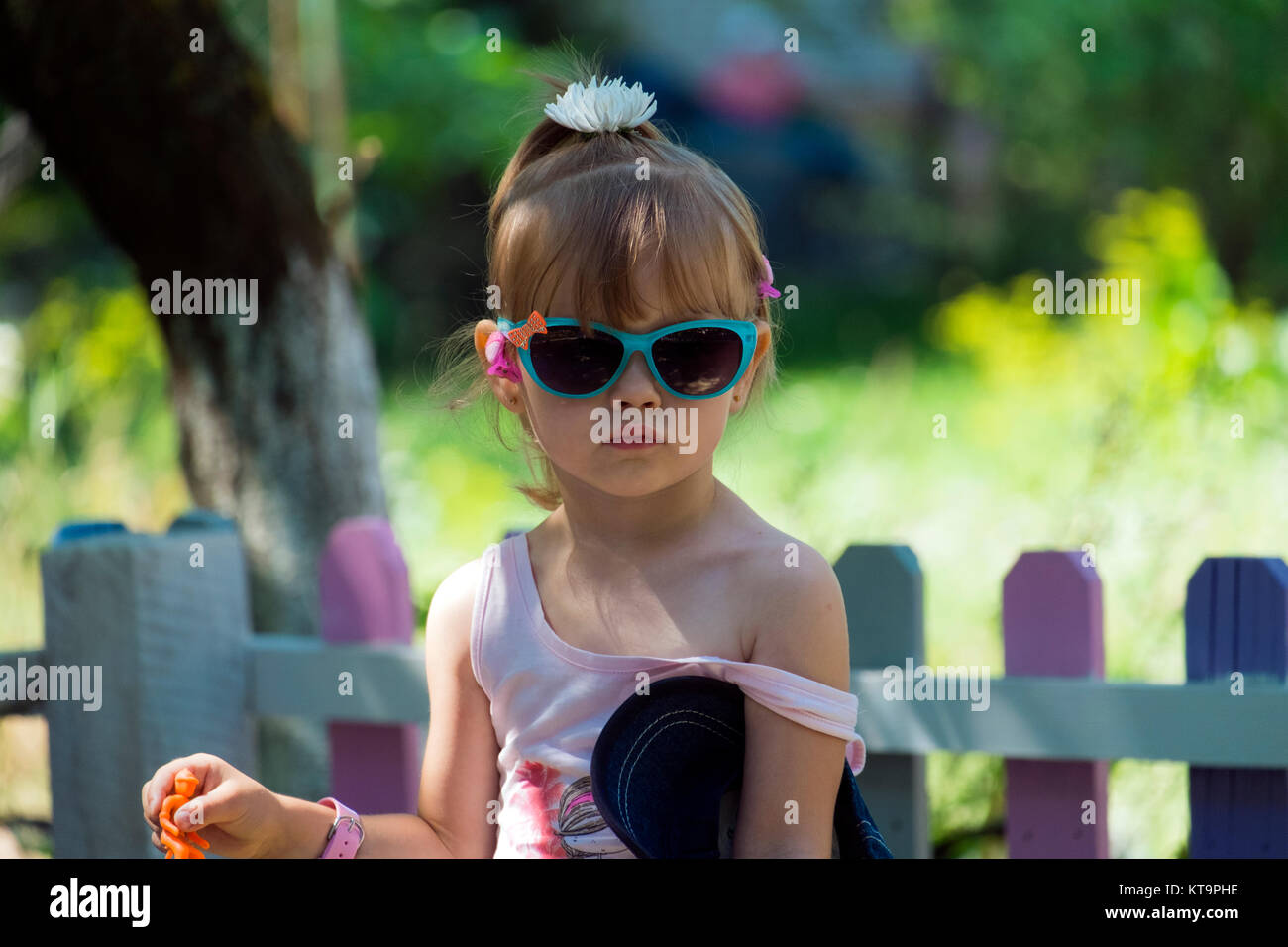 Small fashionista in the glasses with her bare shoulder - Stock Image