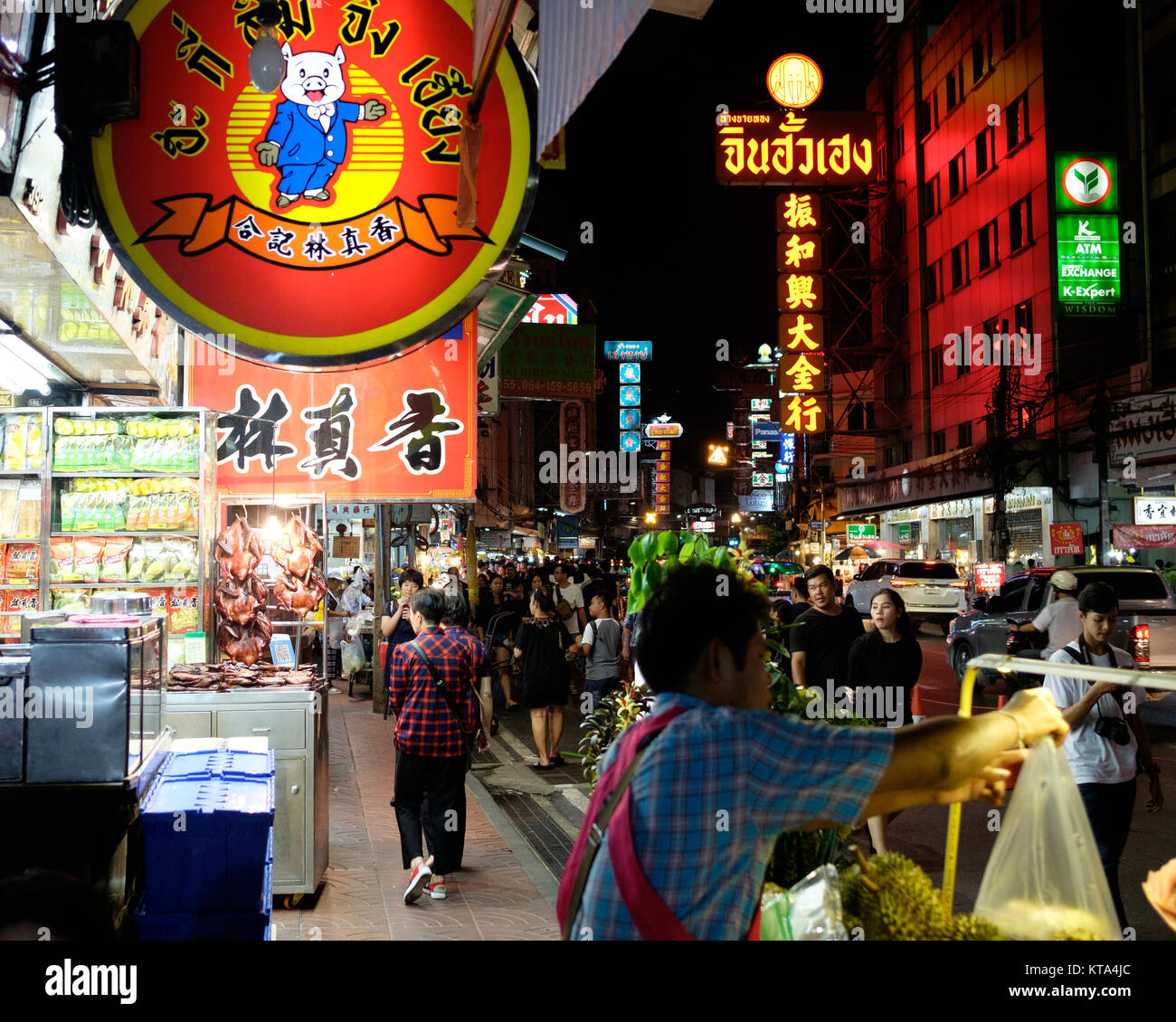 A street vendor sells Durian on the Yaorawat Road in Bangkok's Chinatown, crispy duck and neon signs very typical - Stock Image