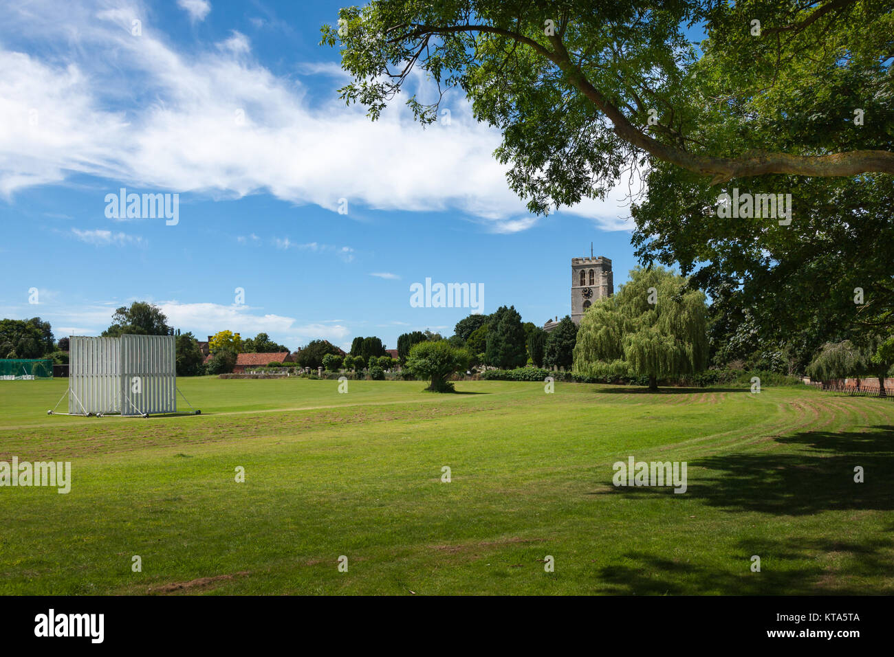 Cricket ground with church in background Thame Oxfordshire UK - Stock Image