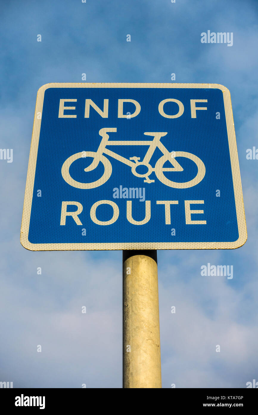 End of cycle route, white on blue sign, in England, UK, used where bicycles can ride on part of a pavement or road, - Stock Image