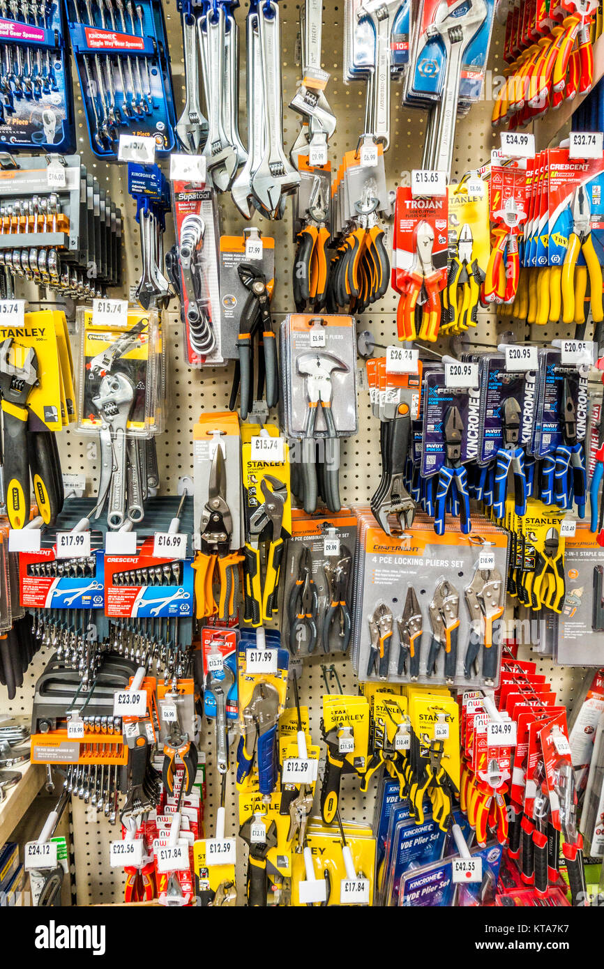 Extensive, colourful tools selection of pliers, cutters, spanners and wrenches, of varying size, on display in a - Stock Image