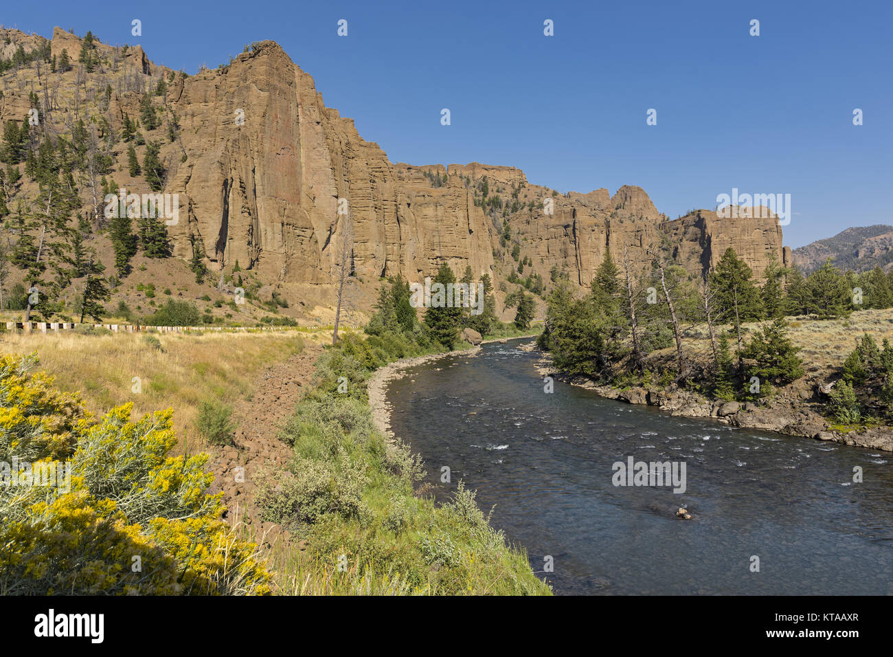Red rock cliffs over the North Fork Shoshone River East of Yellowstone National Park Near Cody Wyoming - Stock Image