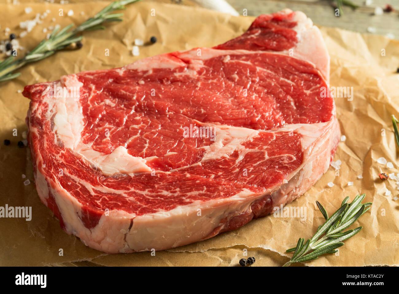 Raw Grass Fed Boneless Ribeye Steak Ready to Cook Stock Photo