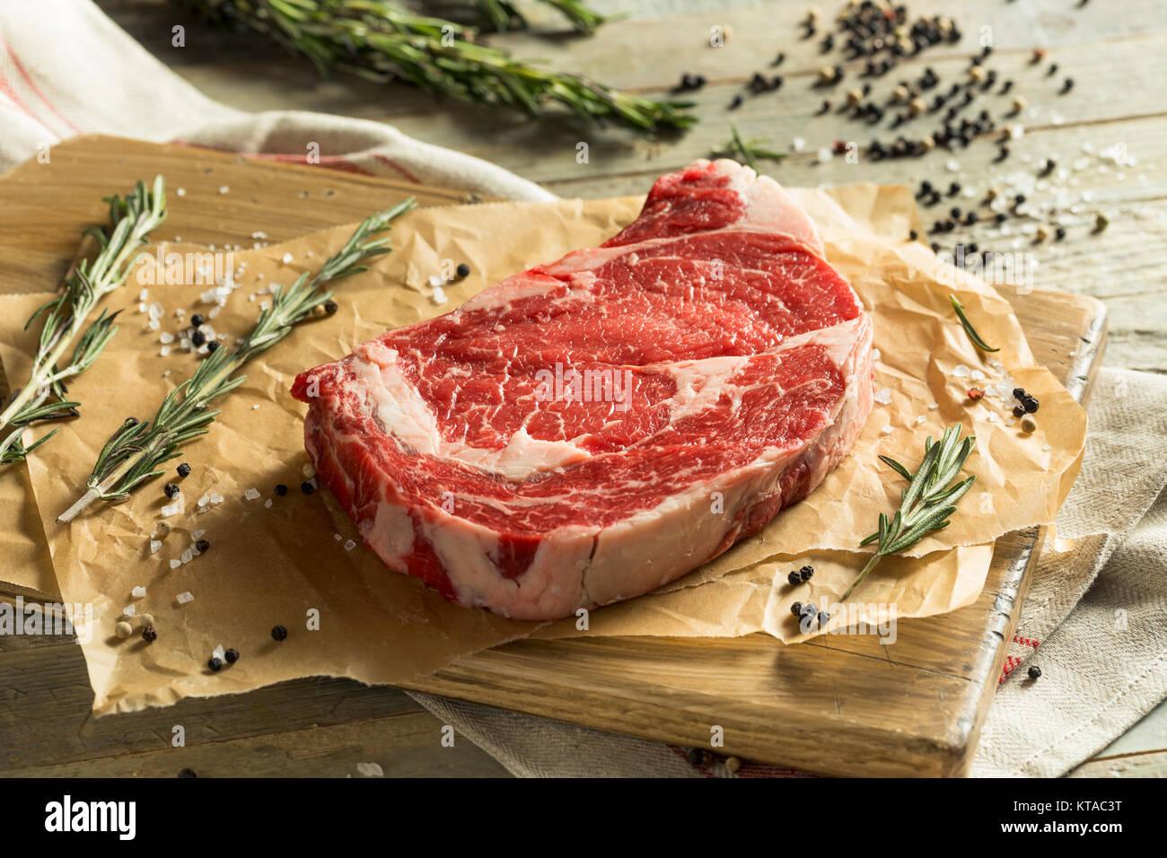 Raw Grass Fed Boneless Ribeye Steak Ready to Cook - Stock Image