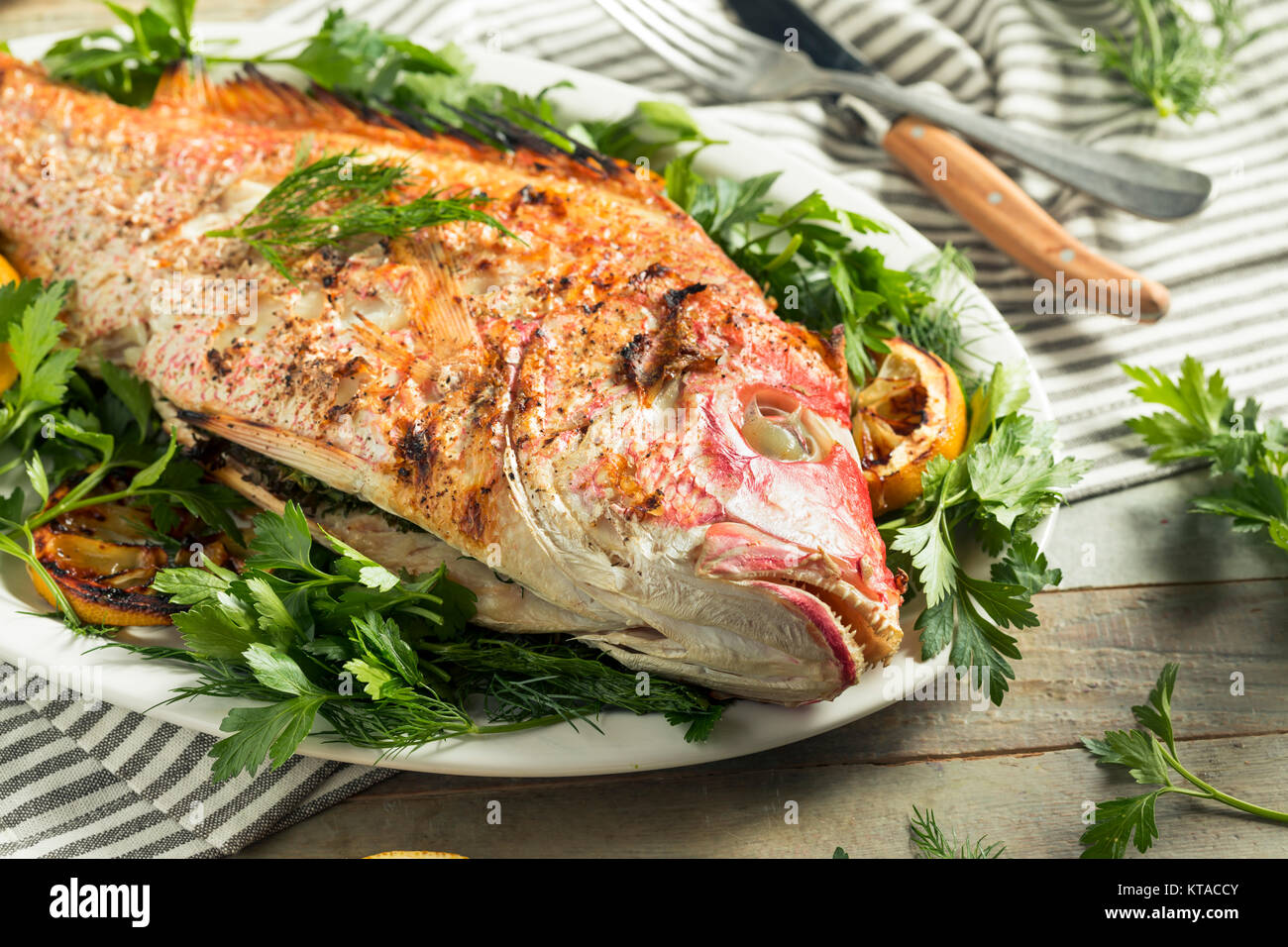 Homemade Grilled Whole Red Snapper with Lemons and Dill Stock Photo