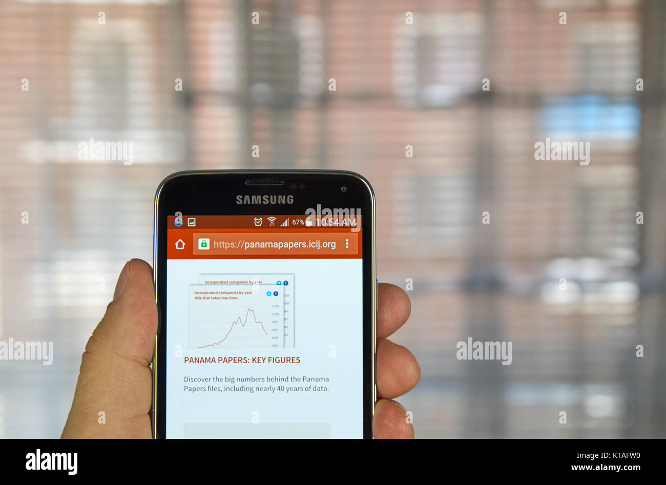 MONTREAL, CANADA - APRIL 5, 2016 : ICIJ web page on mobile phone. ICIJ is International Consortium of Investigative - Stock Image