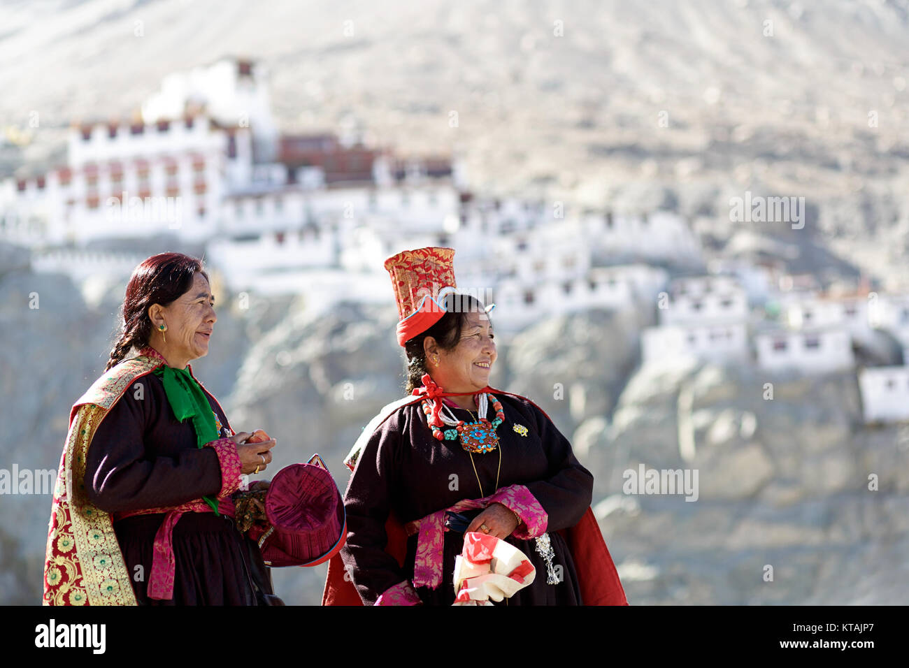 Two women in traditional costumes and headwear at annual festival at diskit Monastery, Nubra valley, Ladakh, Jammu - Stock Image