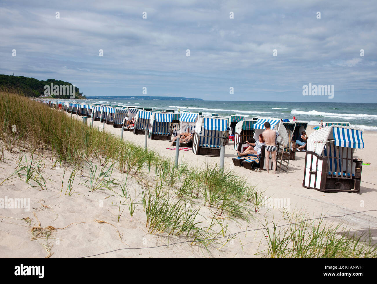 People and beach chairs at the beach of Baabe, Moenchgut-Granitz, Ruegen island, Mecklenburg-Western Pomerania, - Stock Image